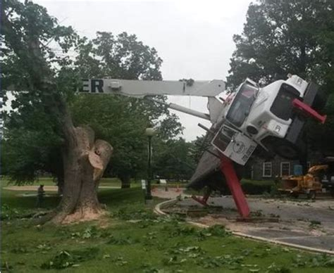 overturning boom truck hits lift crane accidents