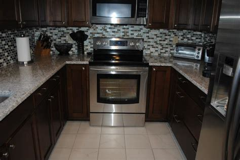 granite kitchen tiles maple briarwood cabinets with black glaze pearl 1301