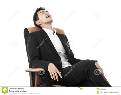 businessman sleeping on a chair stock photo image 36707318