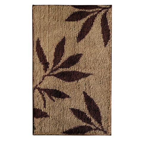 bathroom rugs interdesign leaves 34 in x 21 in bath rug in brown tan 17411 the home depot