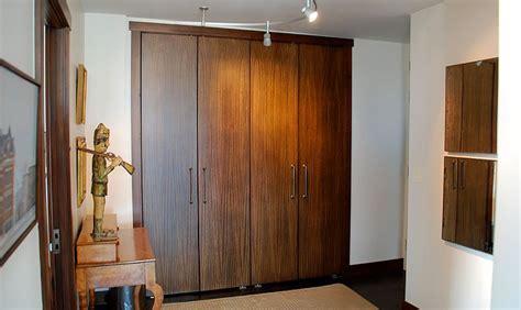 Brandner Design Slab Pivot Closet Doors