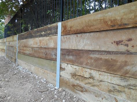 wood post retaining wall wood post retaining wall pictures to pin on pinterest pinsdaddy