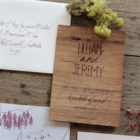 holiday stationery earthy wood and floral wedding invitation from akimbo