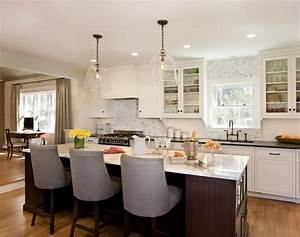 Glass pendant lights over kitchen island : Kitchen island with beadoard trim transitional