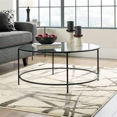 Round coffee tables are classic in any home making it look great. Round Contemporary Coffee Table in Black   Mathis Brothers Furniture