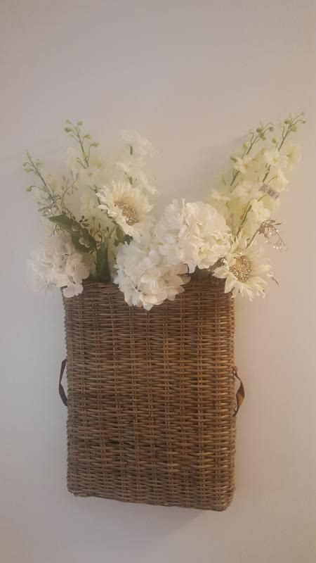 They do so many things. Gathering Basket Wall Décor in 2020 | Baskets on wall, Basket wall decor, Wall decor
