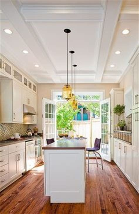 wide galley kitchen  patio doors google search