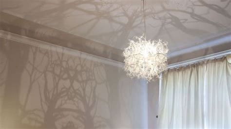 the chandelier that transforms your room into an enchanted