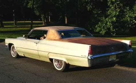 cadillac coupe deville big  green