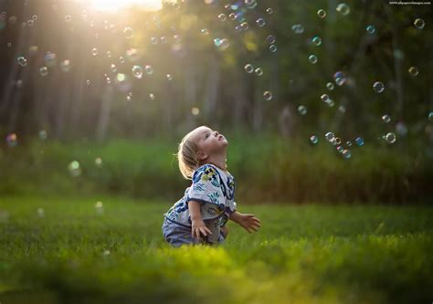cute baby girl playing  soap bubbles images hd