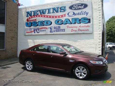 Newins Ford by 2010 Ford Taurus Sel In Cinnamon Metallic Photo 5