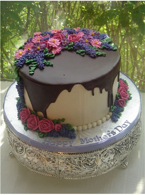 Wilton cake decorating on instagram: Elegant Happy Mother's Day cake with chocolate decor.PNG (3 comments)