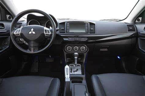 mitsubishi adds features  packages   lancer