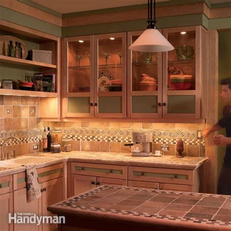 kitchen glass cabinet lighting how to install under cabinet lighting in your kitchen