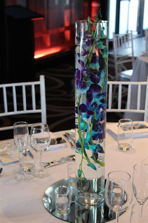 reception table centerpiece of blue singapore orchids