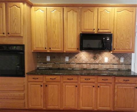 granite countertops for oak kitchen cabinets honey oak cabinets with verde butterfly countertops 8337