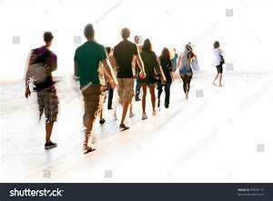 Blurred Young People In Casual Dresses Walking In A Line ...