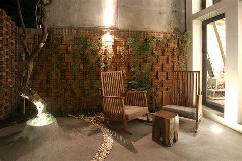nghia architect encloses maison T behind a brick façade