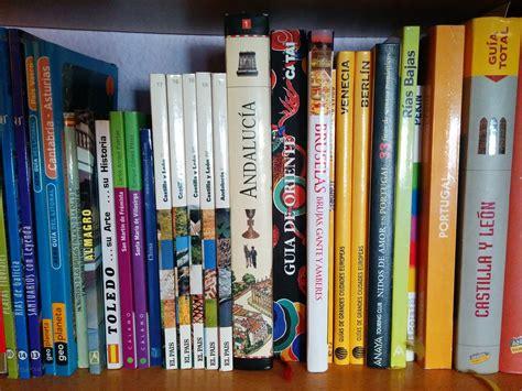 travel books shelving  photo  pixabay