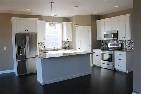 white kitchen  large center island kitchen
