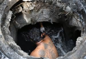 clogged basement floor drain sludge bangkok workers who to clean out the sewers by