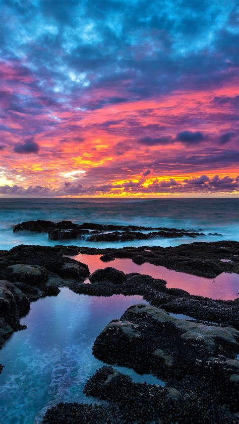 sunset  rocky beach  wallpapers hd wallpapers id