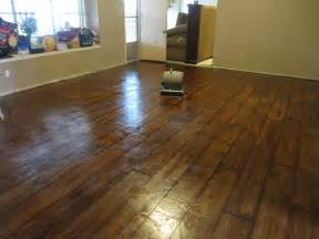 remodel living room design with brown vinyl flooring that looks like wood planks for ranch