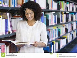 Woman Reading In A Library Stock Images - Image: 6075064