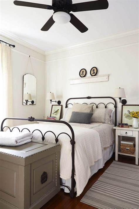 modern vintage bedroom  black framed bed founterior