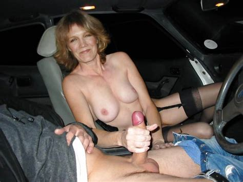 nude wife gives handjob in the car