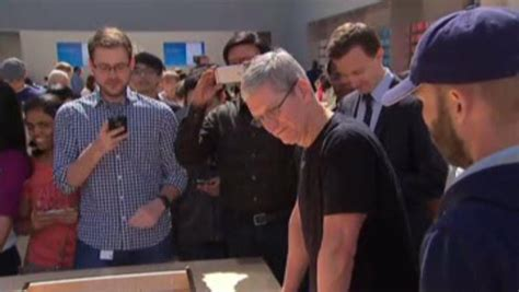 apple ceo tim cook shows his white stainless