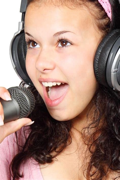 girl holding  microphone   headphone  stock