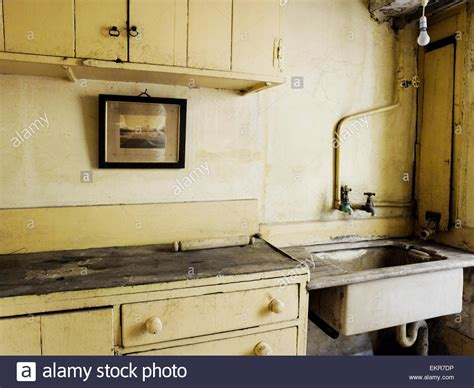 fashioned kitchen sink an fashioned kitchen sink and cupboards stock photo 3634