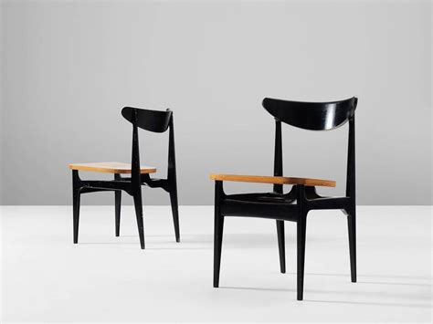 set of 12 black wooden dining chairs for sale at 1stdibs