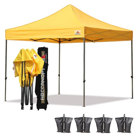 pop up canopies abccanopy 10x10 deluxe yellow pop up canopy with roller