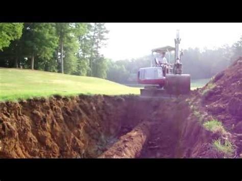 mini excavator digging   pipe youtube