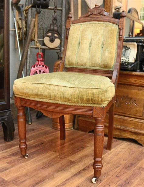 Antique Carved Eastlake Chair With Porcelain Wheels