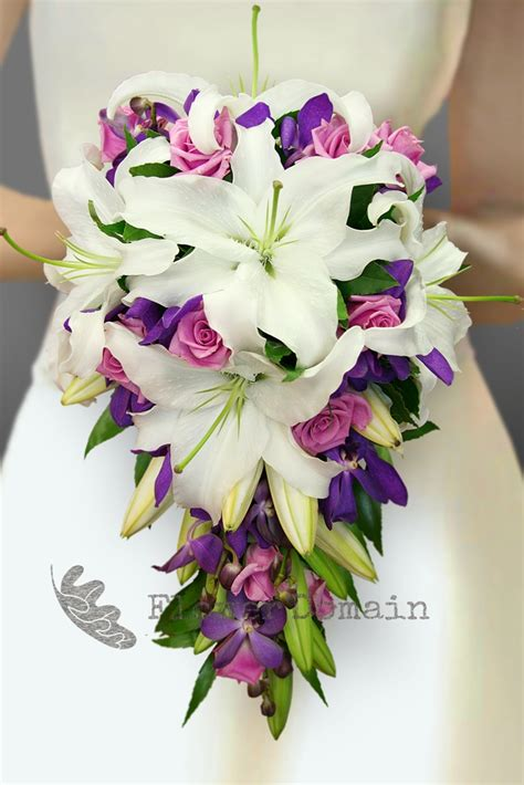 white oriental lily purple orchid and mauve rose trailing