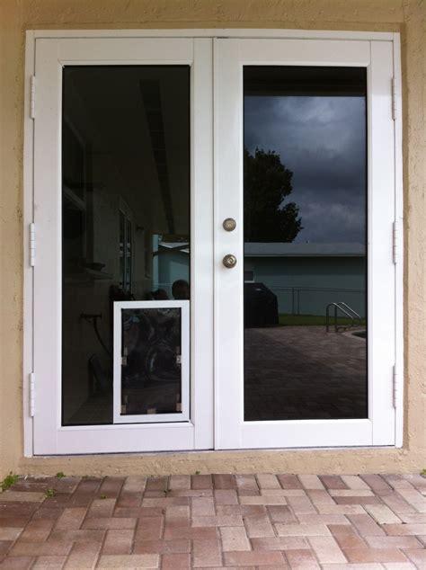 sliding glass door with doggie door built in jacobhursh