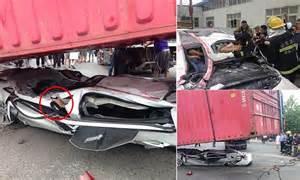 crash victims survive  car  crushed flat  lorrys
