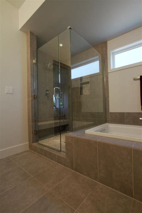Modern Spa Bathroom With Large Glass Shower Next To Soaker