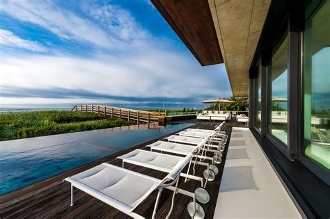 wooden deck infinity pool sea views oceanfront home