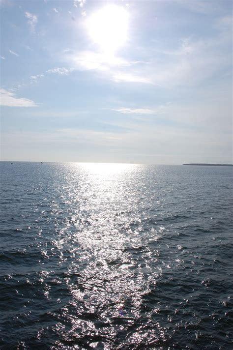 sun glistening   water photo