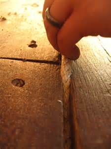 diy how to fill gaps in plank wood floors and scarlet