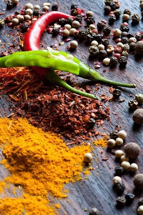 Spices are scattered on a table   Stock Photo   Colourbox