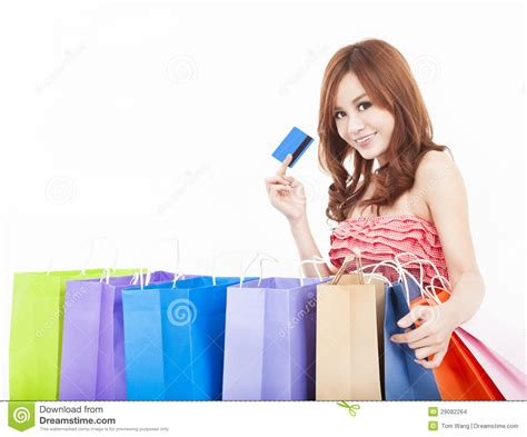 Young Woman Holding Credit Card With Shopping Bags Stock