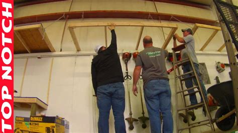hanging overhead storage shelf  garage  commercial