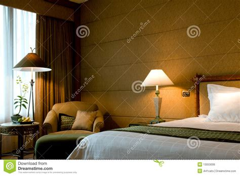 Bed And Armchair In A 5 Star Suite Bedroom Stock Photo