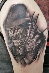 Realistic Grey Ink Freddy Tattoo On Left Shoulder
