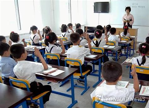 korean parliament approves  year compulsory education